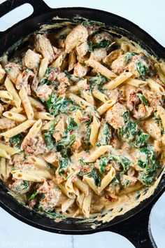 This Creamy Tuscan Chicken Pasta is garlicky, cheesy, and delicious. And the best part is that it only takes 30 minutes to make! Chicken Pasta Dishes, Tuscan Chicken Pasta, Creamy Chicken Pasta, Jerk Chicken Pasta, Chicken Florentine Pasta, Cooked Chicken, Shrimp Pasta, Chicken Fajitas, Chicken Bacon
