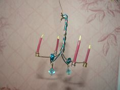 Handmade Miniature Fairy Chandelier with Four Candles and Swarovski Crystals. $7.00, via Etsy.