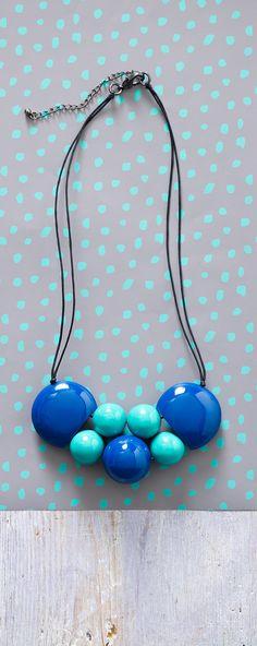 Akela Circular Necklace: Polished Resin Beads in blues