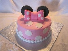 Minnie Mouse Birthday Cake, with a big pink Minnie style bow and matching ears. Cute and simple. Perfect for a little girl's birthday party Bolo Da Minnie Mouse, Minnie Mouse Birthday Cakes, Minnie Cake, Baby Birthday, First Birthday Parties, First Birthdays, Minnie Cupcakes, Birthday Ideas, Minnie Mouse Theme Party