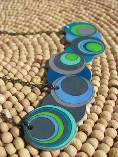 geometric moons shrink plastic necklace - green blue gray