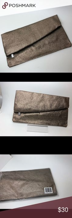 Nordstrom Glitter Bronze Large Clutch w/Zipper NEW We are a non-smoke environment.  We ship Monday-Friday !  Bundles will always get you a better deal!  If you love makeup - we have tons and tons of makeup products right now. Thanks for shopping with us.  SEE MEASUREMENTS IN PHOTOS ABOVE.   Nordstrom zipper pull.  Comes in original packaging.  Non-smoke environment. Nordstrom Bags Clutches & Wristlets #environmentproducts