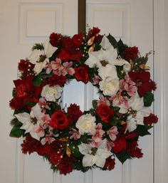 I designed this Christmas wreath for a client and she loved it!  www.customsilkfloral.com