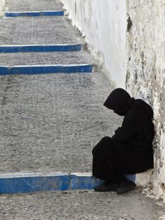 Adam Jones:   Old Woman Resting on Steps, Imerovigli, Santorini, Greece