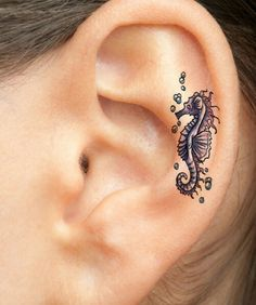 Sea horse ear tattoo