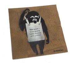 Niet Banksy/STOT21stCplanB - deze Week ik ben meestal bezig met politiek  Corrector vloeistof ingelogd met de STOT21stCplanB bliksem sloeg de man op de rug met een niet door Banksy stickerAfmeting: 50 x 50 cmIn 2007 STOT21stCplanB (aka L-13 van Steve Lowe en Adam Wood) begonnen met het maken van de niet Banksy schilderijen die in wezen een provocerende satirische reactie voor niet zozeer Banksy zelf maar voor de hordes hyped up opportunist speculanten die zijn werk in de hoop dat ze konden…