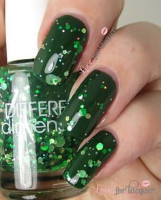 This Is Not Fir - Green jelly with a mix of green & gold glitters. I have this layered over Zoya Hunter. Photo below shows two coats of each.  - See more at: http://www.loveforlacquer.com/2013/12/different-dimension-happy-holly-days.html?utm_source=feedburner&utm_medium=email&utm_campaign=Feed%3A+LoveForLacquer+%28Love+For+Lacquer%29#sthash.h9ioyV1Q.dpuf