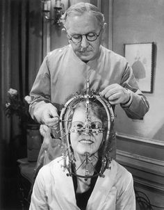 Max Factor takes measurements of the actress Marjorie Reynolds' head and face with his 'Beauty Micrometer,' a device he developed to aid makeup artists, 1934. (Keystone-France/Getty Images)