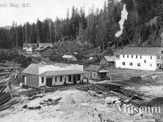 """View of Rock Bay (1911) """"View of bay shows the hotel, store and hospital.""""  Sheila McLoughlin Collection - CR Museum"""