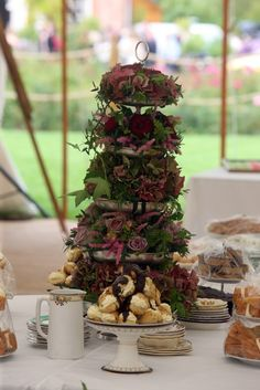 An interesting way to create a floral table centre for a garden party or tea party themed wedding - Loved by Jemini Flowers (www.jemini.co.uk)