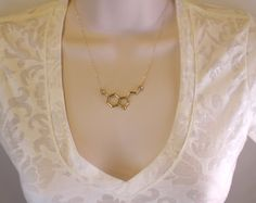 ***This necklace was featured on Buzzfeed and BUST magazine (September 2015 issue)***  24K Gold Serotonin Molecule Necklace.  Serotonin is a modern symbol of happiness. Serotonin molecules interact with receptors in the brain to induce feelings of happiness, satisfaction, and relaxation.  Serotonin also has an elegant shape. As a necklace, it is an attention-grabber. Perfect for the chemistry or biology lover in your family! As a research scientist, this piece is one of my favorites!  The…