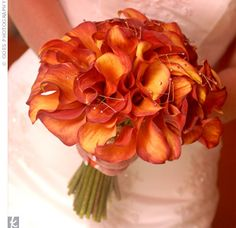 The Bridal Bouquet    Golden-beaded flourishes sparkled in a bouquet of orange calla lilies.