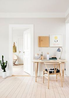 White Space. light floors. Natural, warm, wooden desk and chair. Desk inspiration!
