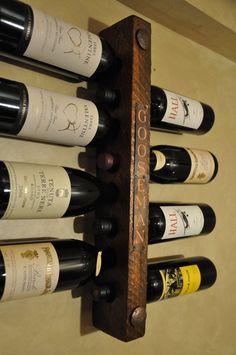 He encontrado este interesante anuncio de Etsy en https://www.etsy.com/es/listing/124155927/personalized-gift-idea-wine-rack