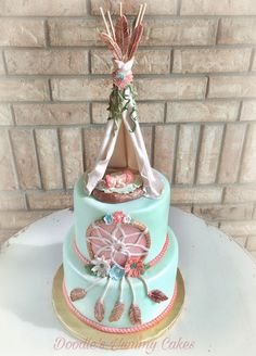 Boho baby shower cake with teepee and dream catcher.