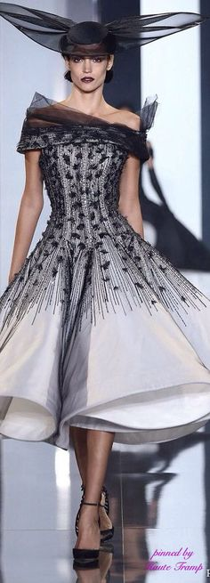 High fashion hats are often designed to compliment a designer dress: Ralph & Russo's Fall-Winter 2014-2015 haute couture collection.
