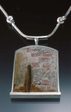 "Alley Pendant Tom McCarthy 2005  Sterling, concrete, steel & rust.  2 1/4"" x 1 1/2"" x 1/4""."