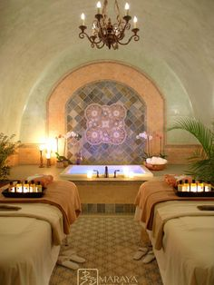 I don't like the background or room. What I do like is the ambiance created with candles and a water feature in the background, which does not have to be a tub!