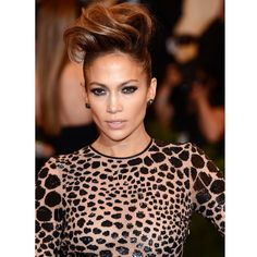 J.Lo's less dramatic take on the mohawk worked perfectly at the 2013 Met Gala. The slicked down sides and structured top makes for a look that's great for the red carpet or a night out with the girls.