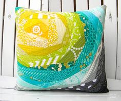 Newtown Auction QAYG Pillow.  Tutorial found at http://letseatgrandpa.com/2013/01/29/bloomin-quilt-as-you-go-panel-tutorial/