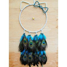 Peacock Hello Kitty Dreamcatcher. By Village Dreams on Etsy.