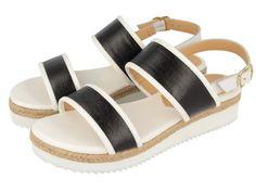 Luanca / Sandalias planas con suela blanca, tiras en negro y detalles en marrón. Altura de 3,5cm. Corte, forro y suela en sintético. Unas cómodas sandalias de verano de tendencia total esta temporada SS16.