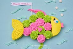 Fish Cupcake Cake Recipe ~ How to make a fun & simple fish design! It's the perfect centerpiece for summertime or beach themed parties, and all you need are cupcakes & a round cake layer!