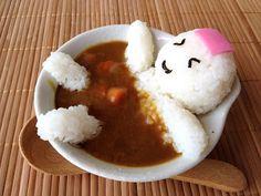 Onigiri man in curry onset.  Kawaii!!
