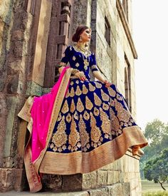 Aesthetic blue color velvet Lehenga  beautified with golden Zari work