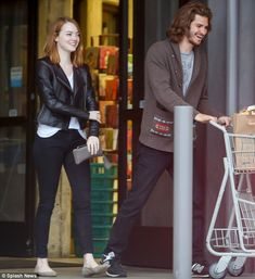 Happy together: Emma Stone and Andrew Garfield shared a laugh as they were spotted leaving...