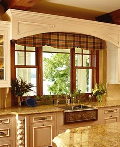 Flanking the picture window with grilled, double-hung windows provides a moreopenfeel to the space and allows in additional light while retaining atraditional look .,Double Hung Window by Kolbe & Kolbe Rustic Windows And Doors, Double Hung Windows, Wood Windows, Kitchen Cornice, Kitchen Valances, Kitchen Design, Kitchen Decor, Kitchen Ideas, Kitchen Inspiration