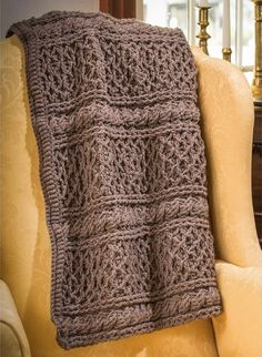 Keep warm under the highly-textured Mrs. Hughes' Afghan from Premier Yarns. Crocheted in Branson yarn, an incredibly soft blend of acrylic and wool from the Downton Abbey collection, this is a quick project that'll fly off your hook!