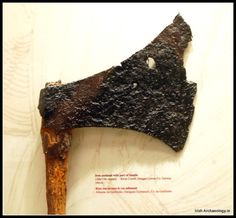 A 12th/13th century battle axe with its original wooden haft still attached, from River Corrib, Co Galway, Ireland