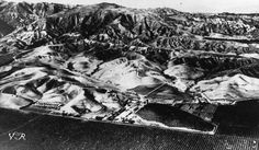 Sunshine Ranch in Granada facing north, with the Santa Susana Mountains in the background, ca. 1932. The citrus trees are on the south side of Rinaldi Boulevard.