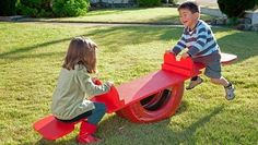 DIY Tire See Saw #DIY #Tires #SeeSaws #Kids #Toddlers #Toys #Outdoors
