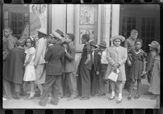 Children in front of moving picture theater, Easter Sunday matinee, Black Belt, Chicago, Illinois, 1941