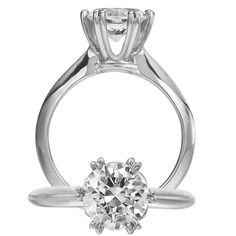Ritani Setting diamond engagement ring featuring a prong set round cut centerstone and a solid metal shank.