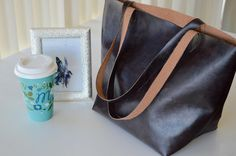 """Designer purses are often extremely expensive but you can create a fabulous designer-inspired bag for a fraction of the cost with this One Yard Leather Bag. Choose your favorite fall color in real or faux leather and create a roomy and trendy bag that looks expensive but doesn't make you break the bank. This free sewing tutorial is easy and quick and shows you how to create the perfect bag for fall weather. This <a href=""""http://www.allfreesewing.com/tag/Knockoff"""" target=""""_bl..."""