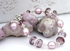 Crystal Antique Pink Swarovski roundlets with light raspberry cultured freshwater pearls and  sterling silver accents and chain.