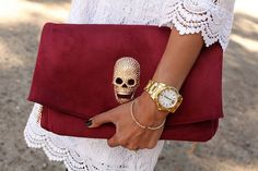 white lace dress and red suede skull clutch handbag