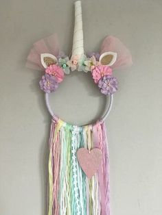 Items similar to Unicorn Dreamcatcher / Wall Hanging / Nursery Decor on Etsy A handmade unicorn Dreamcatcher made using a hoop and tassels measuring around long. If you would like to pick your own colours just pop a note on your order with any requests. Unicorn Rooms, Unicorn Bedroom, Unicorn Wall, Unicorn Decor, Diy And Crafts, Crafts For Kids, Arts And Crafts, Crafts With Yarn, Unicorn Crafts