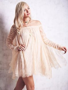 Angel Lace Trapeze Mini Dress   Femme lace babydoll. Dramatic lace panels cascade from sheer ruched sleeves to complete the look. Bodice lined.