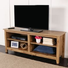 Display your TV in style with this wood media stand. Crafted from high-grade MDF…