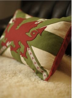 Welsh flag pillow... I love this so much i wish i had this in my home :-)