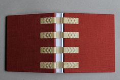 Long-stitch Notebook Covered with Rusty Red Linen by paperiaarre