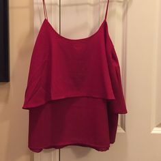 Red Ruffle Tank Super cute ruffle tank top! Only worn one time and it's still in perfect condition! 100% polyester Paper Crane Tops Tank Tops