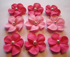 LOT of 100 Royal Icing Flowers w/ silver sugar balls for Cake Decorating.  via Etsy.
