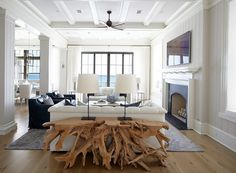 Tongue and groove walls, coffered ceiling and driftwood table from South of the Market. l Coastal Living Rooms l www.DreamBuildersOBX.com