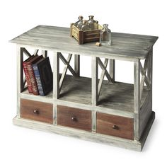 Boldly combining brown wood tones on the drawer fronts with a gray driftwood patina overall gives this table a compelling sophistication – distressed and antiqued. Crafted from mango wood solids and w