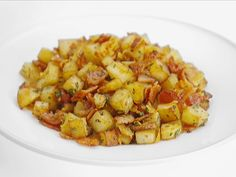 "Giada De Laurentiis' Bacon and Pancetta Potatoes Recipe - One reviewer wrote, ""This was a great dish...and so easy! The trick to getting the potatoes beautiful and brown is not overcrowding the pan. Ideally you want a single layer of potatoes so they cook evenly."""